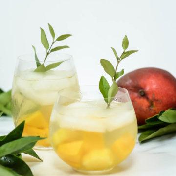A refreshing, make-ahead Tropical Sangria to feed a crowd!