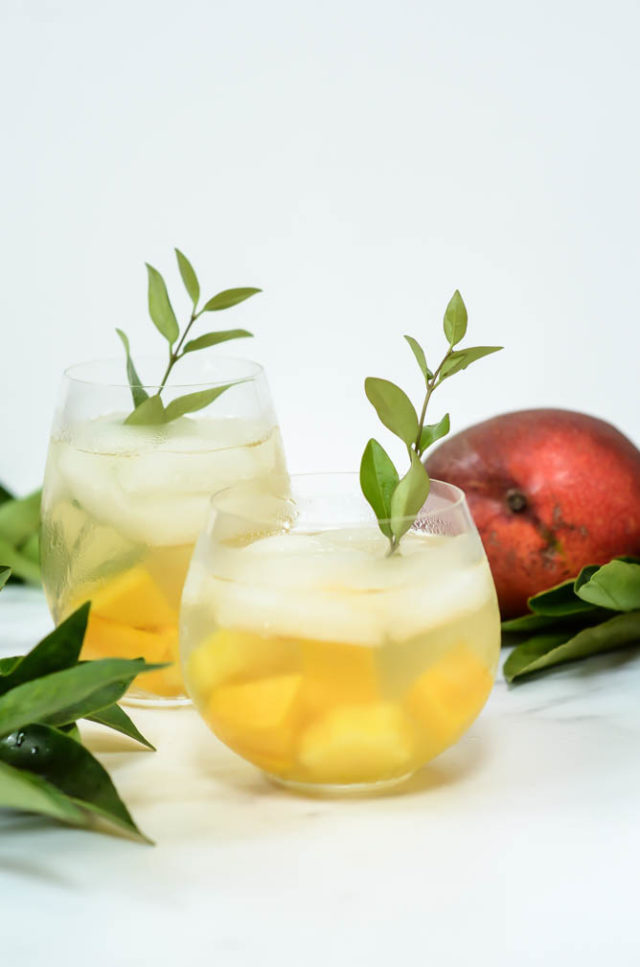 A refreshing, make-ahead Tropical Sangria to feed a crowd!