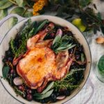 This Red Wine Roast Chicken with Grapes and Herbs is an easy, showstopper entree for fall dinners or holiday entertaining.