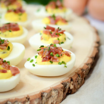 These Candied Bacon Deviled Eggs are the perfect appetizer for your next brunch or Easter get-together. | CaliGirlCooking.com