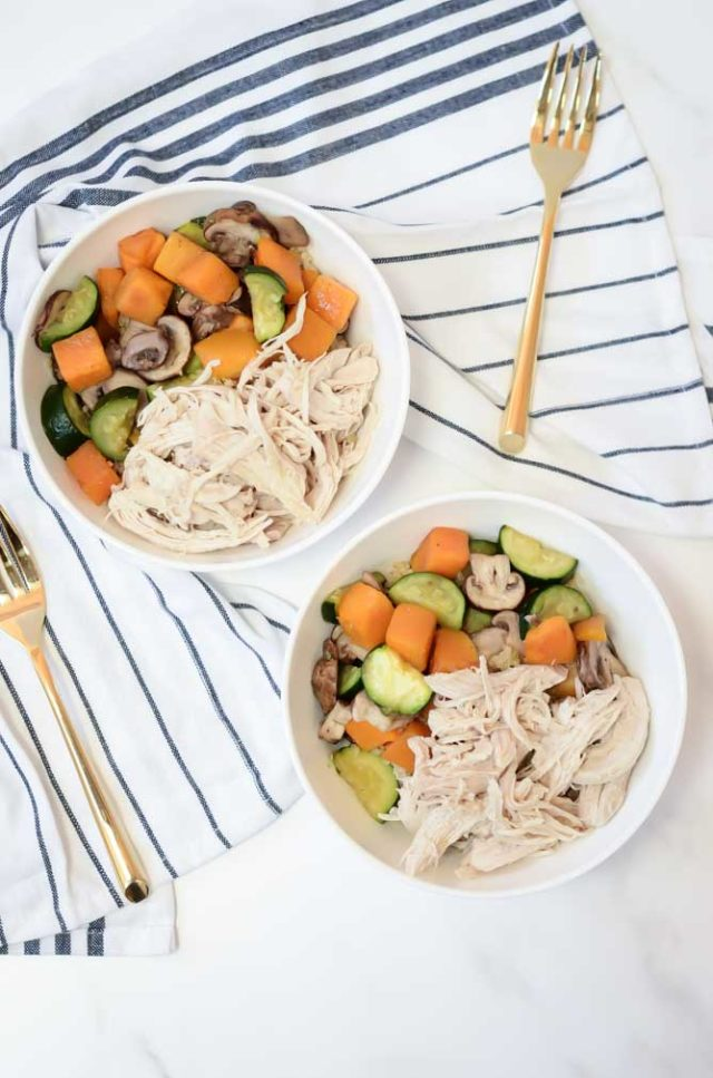 Two hearty bowls of Easy Instant Pot Shredded Chicken loaded with vegetables and whole grains are the perfect healthy meal!