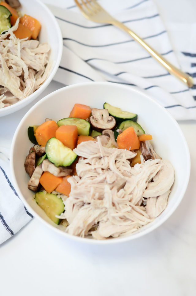 A bowl of the Easiest Instant Pot Shredded Chicken complete with veggies. A great option for baby-led weaning!