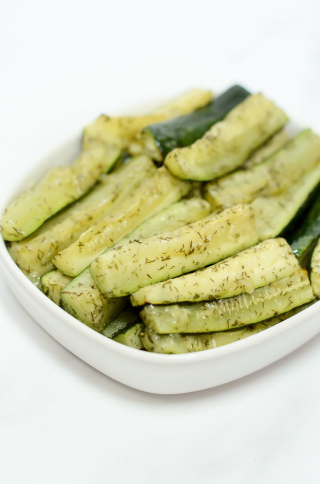 A dish of roasted dill zucchini sticks.