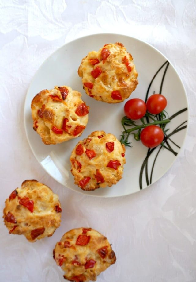 A plate of Savoury Breakfast Muffins adorned with cherry tomatoes.