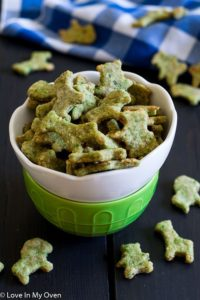 Green Monster Crackers overflowing from a bowl. Another great snack for toddlers!