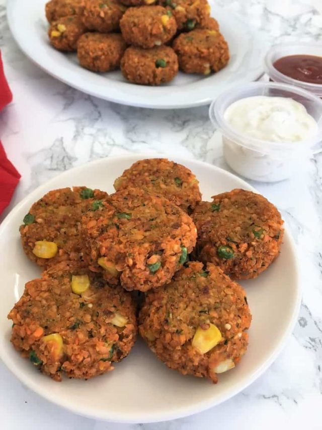 A plate of Baked Lentil Veggie Nuggets - a healthy, baby-friendly finger food!