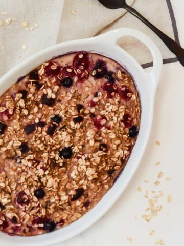 An overhead shot of a dish of beet and berry baked oatmeal, one of the best foods for 9-month-olds!