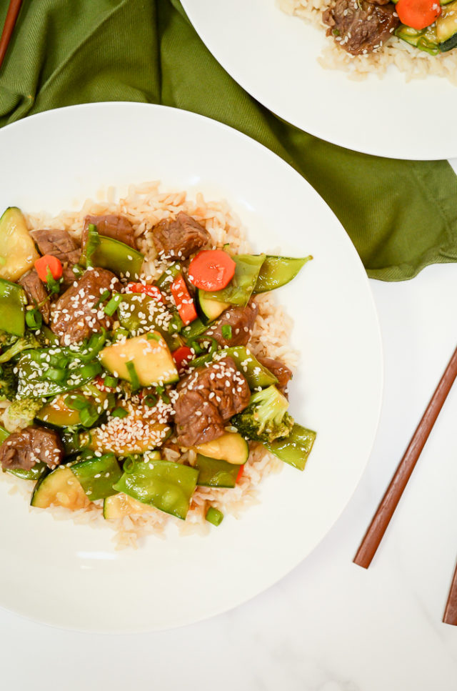 An overhead shot of two delicious plates of Easy Weeknight Beef and Veggie Stir-Fry.