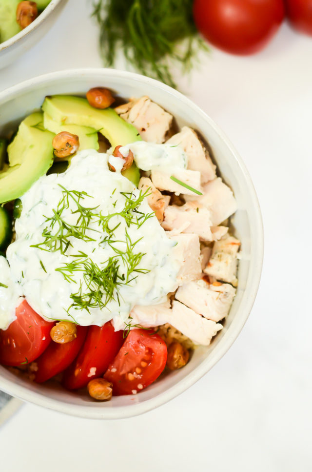 An overhead shot of a healthy Mediterranean Bowl with Tzatziki marinated chicken.