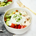 A Mediterranean Bowl loaded with chicken, tomatoes, cucumber and tzatziki.