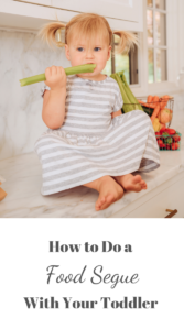 Toddler eating celery on a kitchen counter, title image.