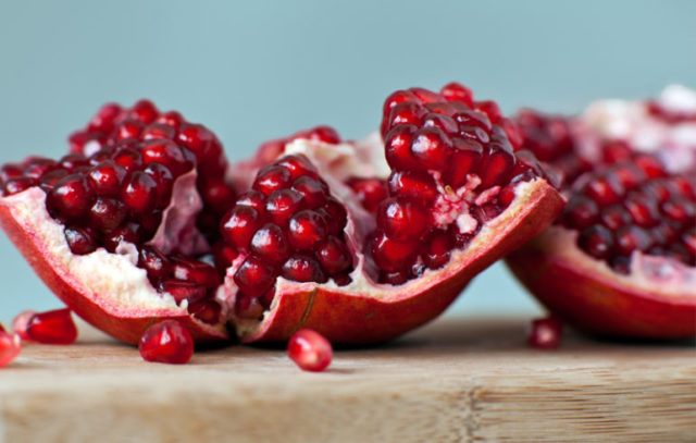A close-up of cracked open pomegranates.