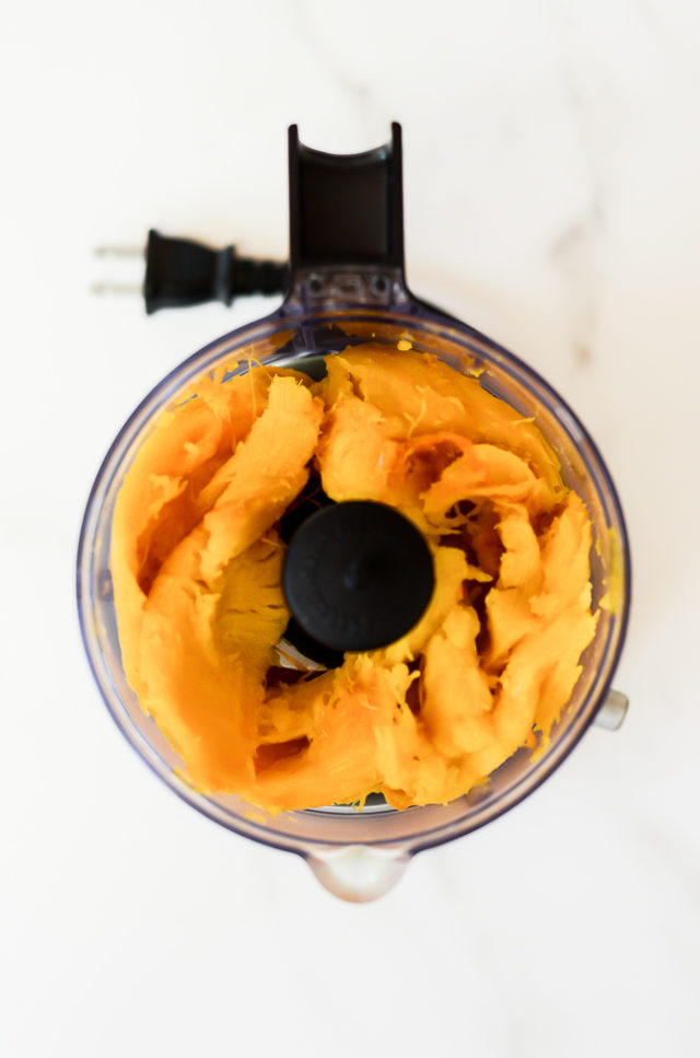 An overhead shot of homemade pumpkin puree in a food processor.