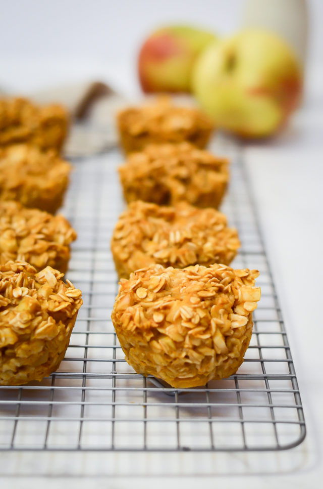A straight-on look at a freshly baked batch of Pumpkin Apple Oatmeal Cups.