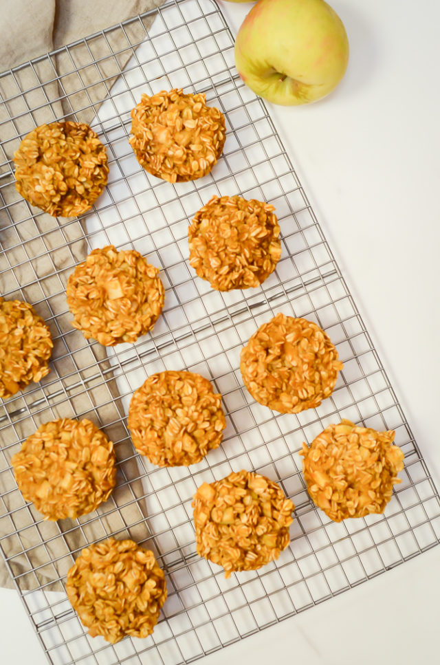 An overhead shot of Pumpkin Apple Baked Oatmeal Cups cooling on a rack.