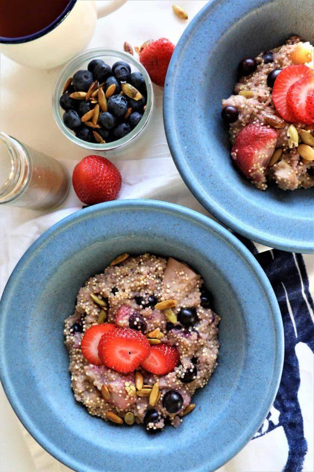 An overhead shot of two Quinoa Berry Breakfast Bowls.