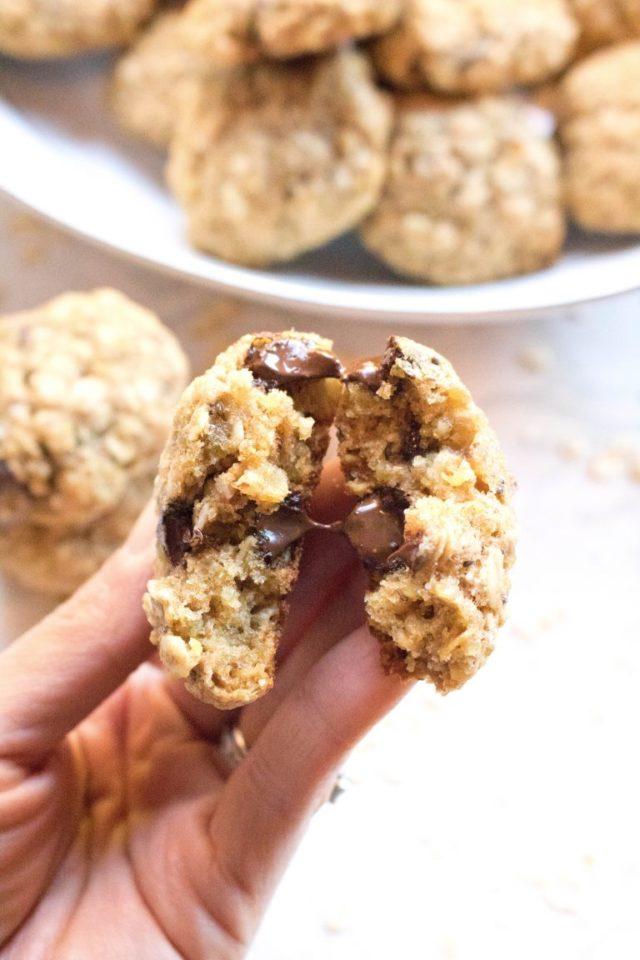 A gooey quinoa chocolate chip cookie broken in half.