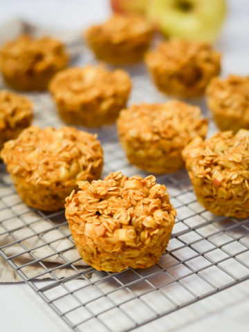 A cooling rack of freshly baked Pumpkin Apple Oatmeal Cups.