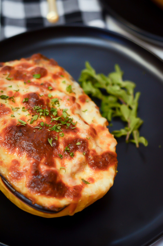 A close up shot of lasagna-style stuffed spaghetti squash.
