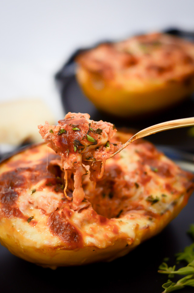 A giant forkful of a stuffed spaghetti squash.