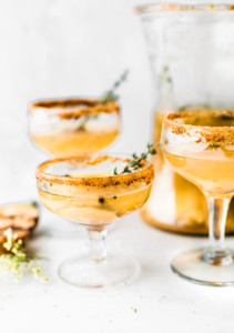 A few glasses and a pitcher of Honey Roasted Pear Sparkling Cocktails.