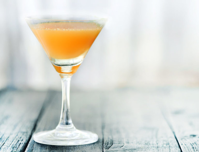 A Vanilla Creamsicle cocktail in a martini glass!