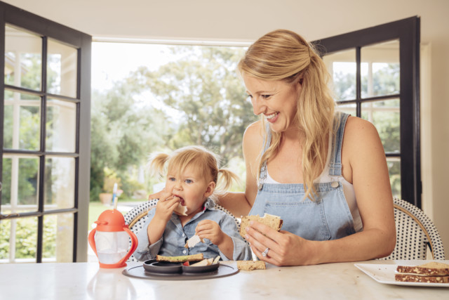 A mom and daughter enjoying a delicious homemade lunch together.