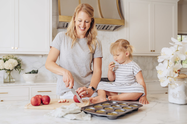 A mom and daughter doing meal prep together in the kitchen.