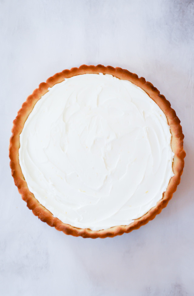 An overhead shot of an almond tart crust filled with a zesty Greek yogurt filling.