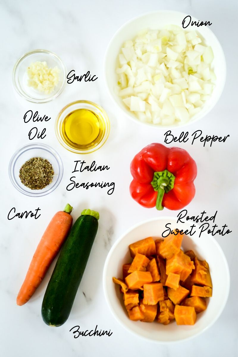 An overhead shot of ingredients you'll need to make Hidden Veggie Pasta Sauce.