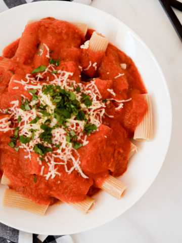 A bowl of penne pasta topped with Hidden Veggie Pasta Sauce.