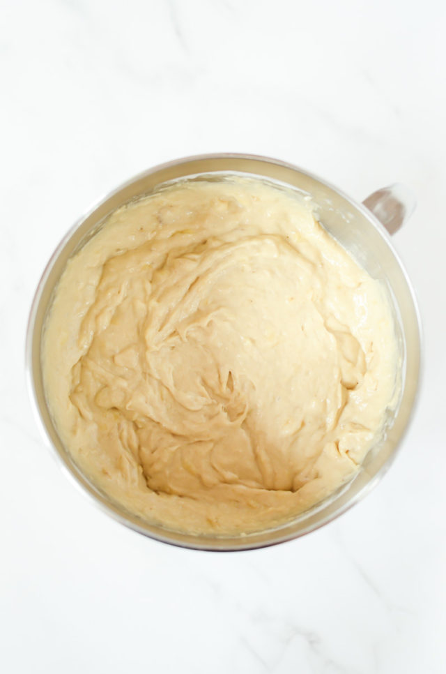 Banana bread batter in a metal mixing bowl.