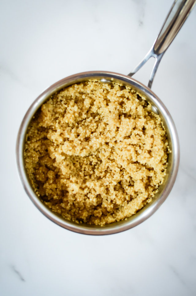 A saucepan of cooked quinoa.