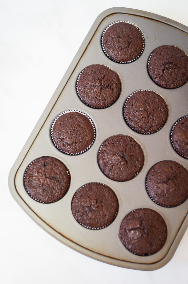 A pan of just-baked chocolate stout cupcakes.