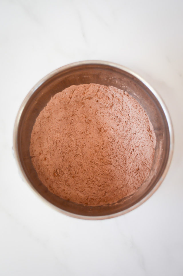 A mixing bowl of dry ingredients for chocolate cupcakes.
