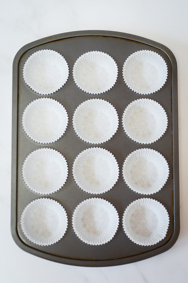 A cupcake tin with paper cupcake liners.