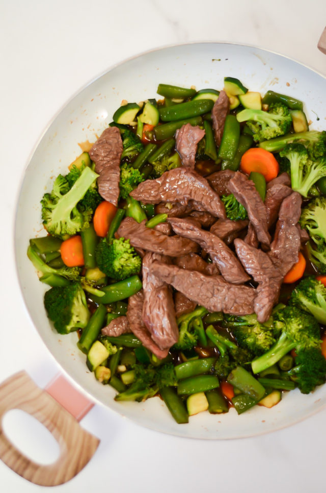 An overhead shot of a pan of beef and vegetable stir-fry.