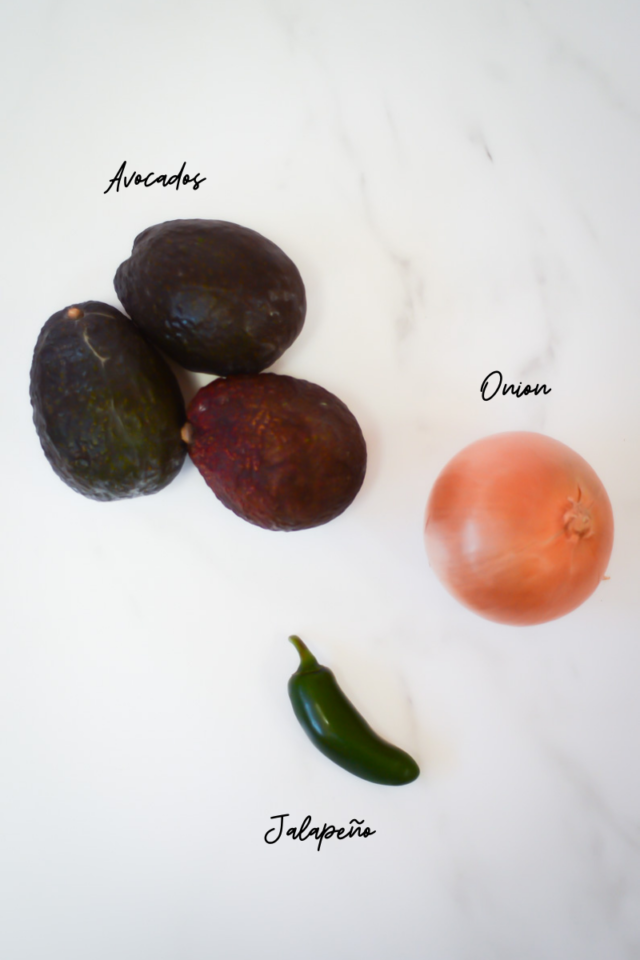 Some of the ingredients needed to make guacamole.