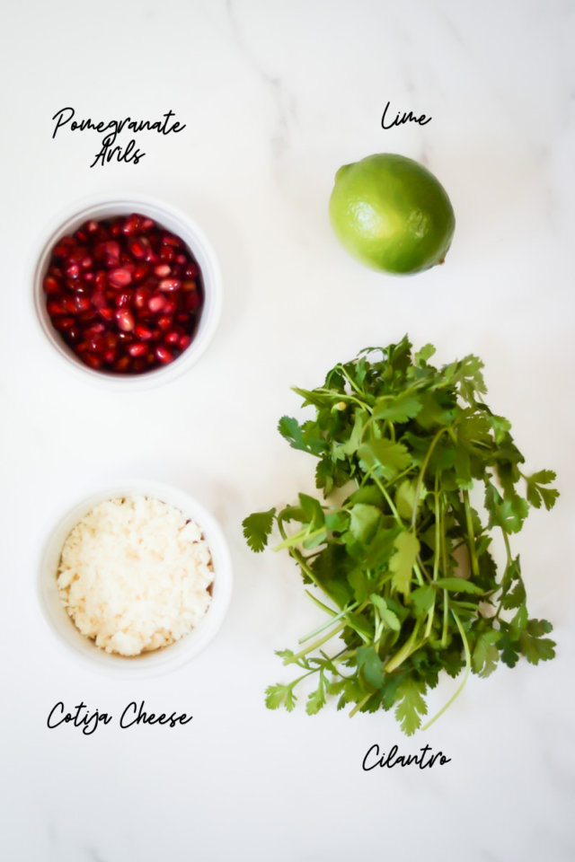 More ingredients needed to make guacamole with cotija and pomegranate.