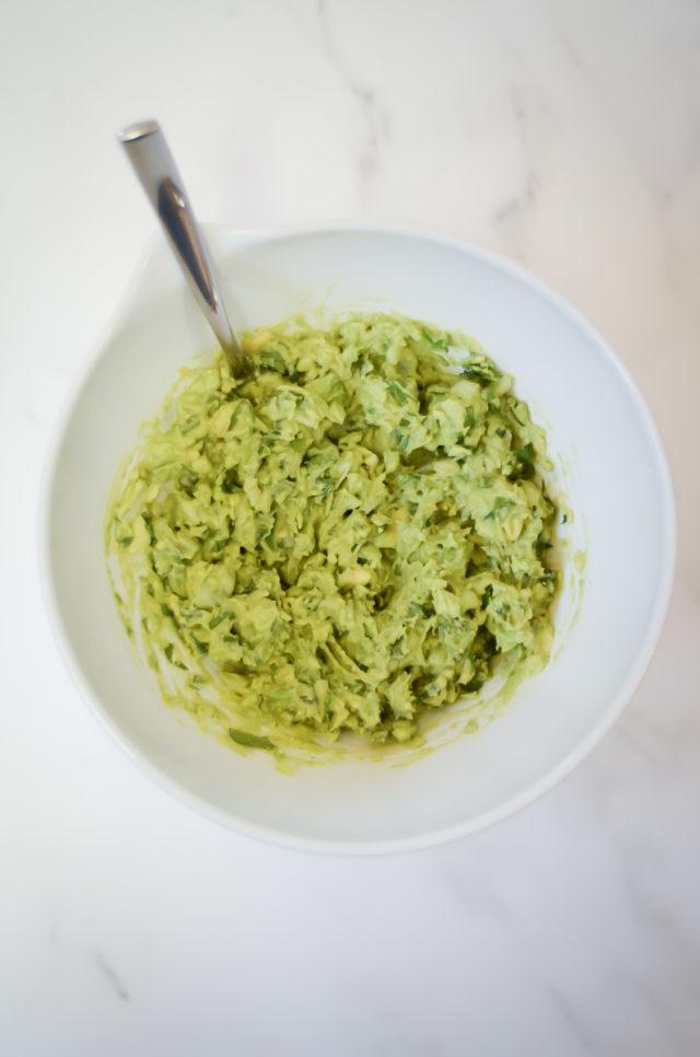 Overhead shot of a mixing bowl of guacamole.