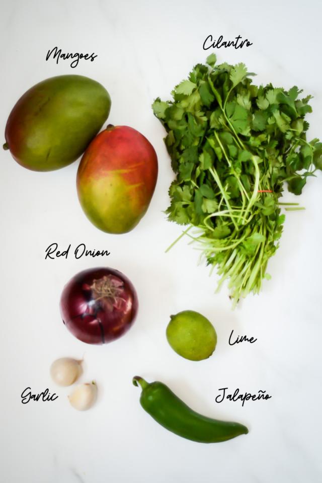 Ingredients needed to make mango salsa.